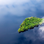 A small island in Lake Mai-Ndombe is revealed through the cloud cover in central region of the DRC, May 14, 2009. ©Daniel Beltra