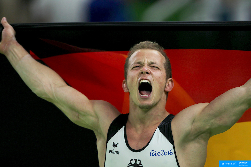 Gymnastics - Olympics: Day 11  Fabian Hambuechen of Germany celebrates after winning the gold medal in the Men's Horizontal Bar Final during the Apparatus Finals at the Rio Olympic Arena on August 16 , 2016 in Rio de Janeiro, Brazil. (Photo by Tim Clayton/Corbis via Getty Images)