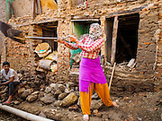 02 MARCH 2017 - SANKHU, NEPAL: A worker digs out a home in Sankhu partially destroyed in the 2015 earthquake. There is more construction and rebuilding going on in Sankhu, west of central Kathmandu, than in many other parts of the Kathmandu Valley nearly two years after the earthquake of 25 April 2015 that devastated Nepal. In some villages in the Kathmandu valley workers are working by hand to remove ruble and dig out destroyed buildings. About 9,000 people were killed and another 22,000 injured by the earthquake. The epicenter of the earthquake was east of the Gorka district.   PHOTO BY JACK KURTZ