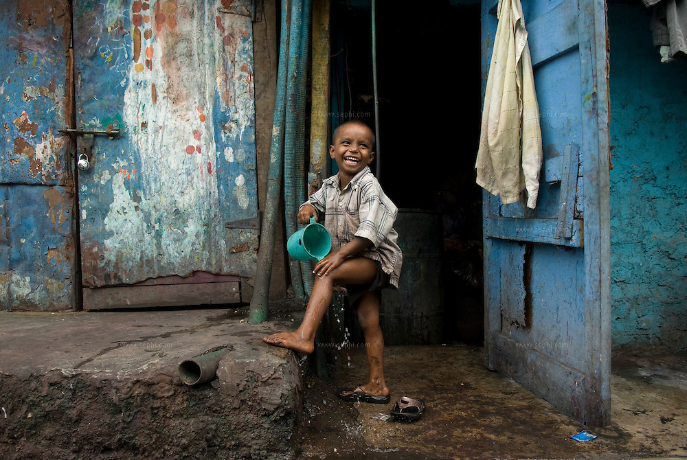 A young boy washing. Dharavi, August 2007