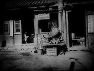 Meat shop in Gyalthang Teng (now known as Shangri La to Chinese).  Kham, Tibet  (Yunnan, China)