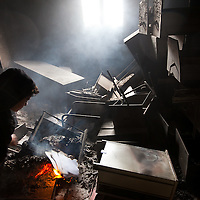 A boy lights a fire in the Tabrurk police station on Feb. 24, 2011. Citizens have burnt all the government offices and are now governing themselves.