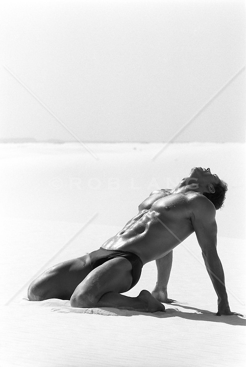 man with a great body on the sand in White Sands, NM