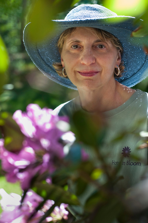 Roberta Hershon, founder of Hope in Bloom..Hope in Bloom is a non-profit organization that plants flower or vegetable gardens free of charge throughout Massachusetts at the homes of women and men undergoing treatment for breast cancer. ..Healing gardens have been proven to be therapeutic sanctuaries offering both comfort and hope to meet the emotional and psychological needs of patients and their families...Photographer: Chris Maluszynski /MOMENT