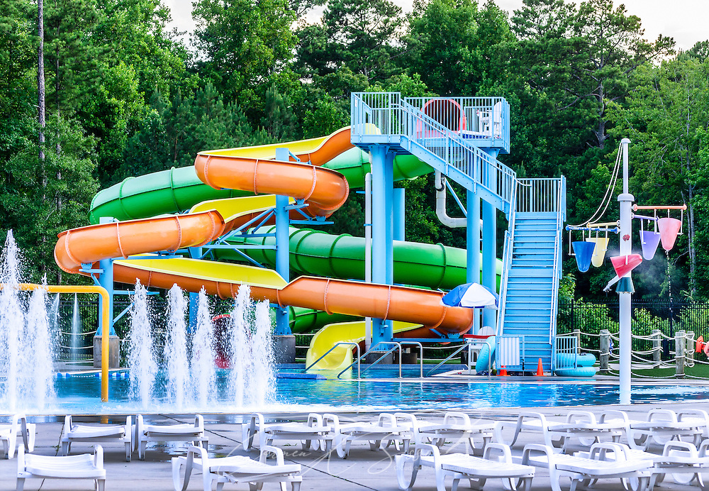 A water slide is pictured after hours at Browns Mill Family Aquatic Center, July 9, 2014, in Lithonia, Georgia. The community pool, located in the Stone Mountain area, is open seven days a week and offers a variety of options for adults and children looking for a fun way to beat the summer heat. (Photo by Carmen K. Sisson/Cloudybright)