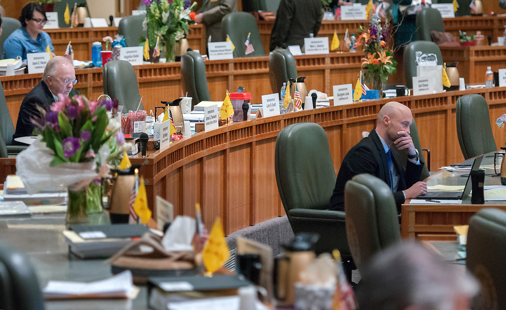 em031717c/a/Rep. James Townsend, R-Atesia, left, and Rep. Bill McCamley, D-Mesilla Park, right, work on the House Floor on the last day of the Legislative Session at the Roundhouse in Santa Fe, Friday March 17, 2017.  (Eddie Moore/Albuquerque Journal