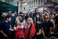 """01/05/2015 – Berlin, Germany: A crowd dances electronic music in Kreuzberg during the """"Myfest"""" street festival. """"Myfest"""" takes place in district SO 36, the traditional centre of riots that usually occur during May Day celebrations and it was organized to decreased the violence caused by Revolutionary May Day Demonstrations.  The radical left wing criticises such events claiming that it is pretended to pacify social conflicts and to ban radical demonstrations. The International Workers Day is a celebration of laborers and the working classes that is promoted by the international labor movement, anarchists, socialists, and communists and occurs every year on May Day. (Eduardo Leal)"""