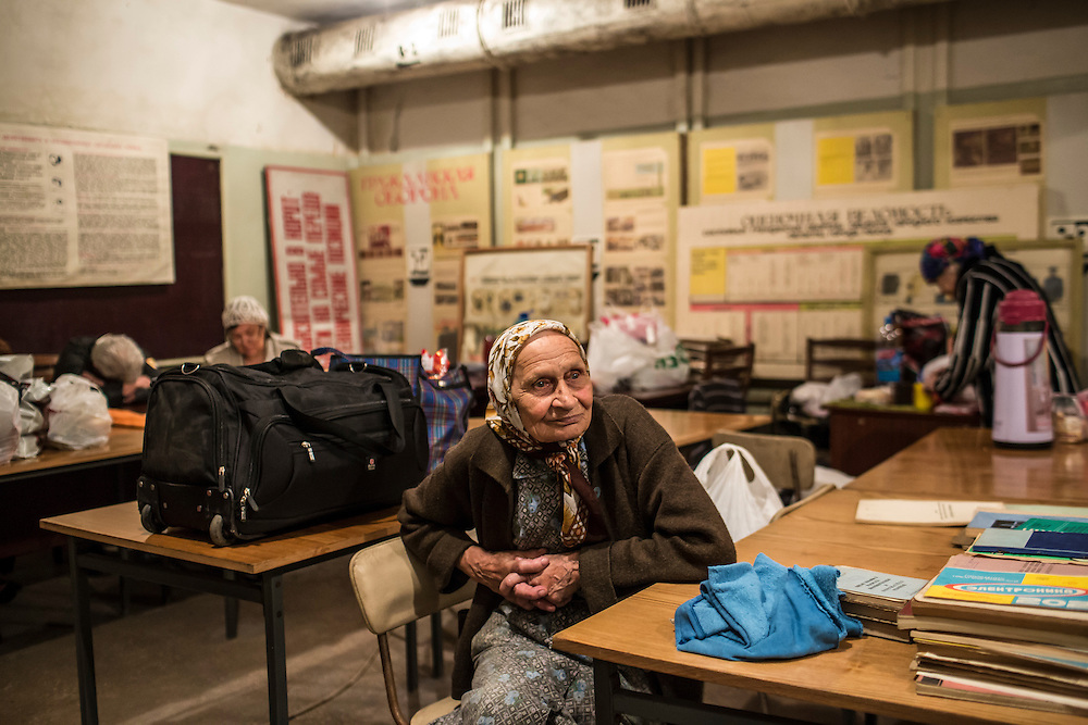 Local residents prepare to spend the night inside an old bomb shelter on Tuesday, July 29, 2014 in Donetsk, Ukraine.