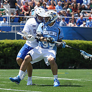 John Hopkins Midfielder HOLDEN CATTONI (99) attempts a shot in the 3rd quarter of a NCAA Division I Men's Lacrosse Tournament game between the defending national champion Duke and No. 8 ranked John Hopkins Sunday, May. 18, 2014 at Delaware Stadium in Newark, DEL
