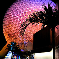 Spaceship Earth at Night at Epcot in Orlando, Florida<br /> As the last of the IllumiNations fireworks bursts over the World Showcase Lagoon, throngs of tired people shuffle towards Epcot&rsquo;s main gate. Before they go, they are treated to one last look at the theme park&rsquo;s 518 foot iconic geodesic sphere: a glowing Spaceship Earth.