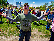 04 MAY 2017 - ST. PAUL, MN: A man prays during a service at the Minnesota State Capitol. About 200 people gathered on the lawn in front of the Minnesota State Capitol in St. Paul for a noon time prayer service on the National Day of Prayer. Similar services were held across the country.     PHOTO BY JACK KURTZ