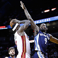12 March 2011: Miami Heat small forward LeBron James (6) goes for the layup against Memphis Grizzlies shooting guard Tony Allen (9)during the Miami Heat 118-85 victory over the Memphis Grizzlies at the AmericanAirlines Arena, Miami, Florida, USA. **