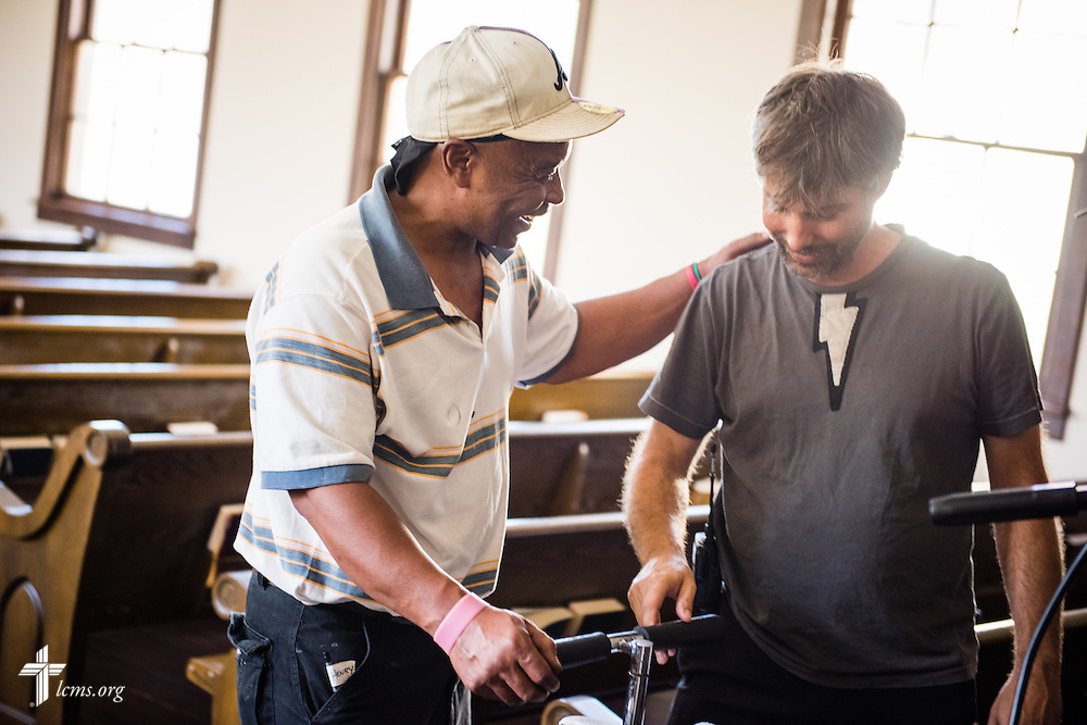 Volunteer Henry Jones pats sound Audio Supervisor Mike Budzik on the back during the final day of filming for 'The First Rosa' documentary on Thursday, September 25, 2014, at Concordia College Alabama in Selma, Ala. LCMS Communications/Erik M. Lunsford