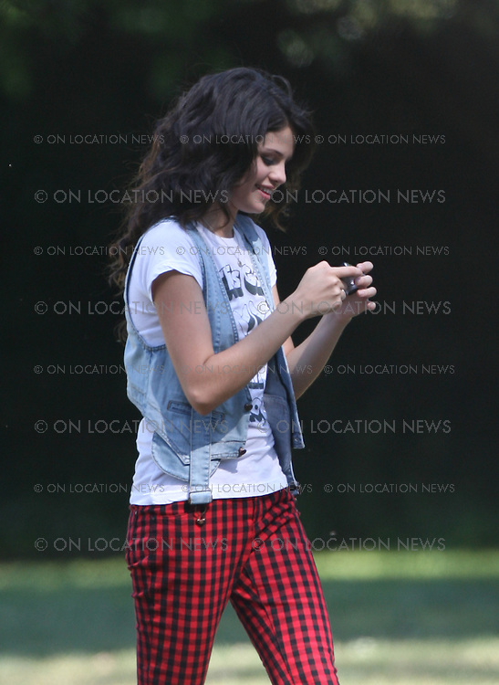 """LOS ANGELES, CALIFORNIA - FRIDAY 25th APRIL 2008. EXCLUSIVE: Selena Gomez (born July 22, 1992) on the set of a People Magazine photo shoot. Selena is expected to be the next tween queen.  Selena is an American actress and singer. Her first role was on Barney & Friends as Gianna. She was discovered by Disney in a nation wide Disney talent search when she was 12 years old. She is currently starring as Alex Russo on the Disney Channel's Original Series,  Wizards of Waverly Place which premiered in October 2007.  Gomez also has a career as a singer, and has recorded three songs for Walt Disney Records. She released a music video for her song """"Cruella De Vil"""" for the premiere of Disney's 101 Dalmatians in February 2008. In 2007, she appeared in the second-season episodes of Hannah Montana as Mikayla, a pop star who is a rival of Hannah Montana..She is also currently co-starring with Drew Seeley in the sequel to the hit movie A Cinderella Story called Another Cinderella Story as the main character Mary. Photograph: On location News. Sales: Eric Ford 1/818-613-3955 info@OnLocationNews.com"""