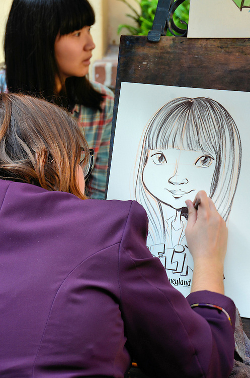 Caricature Artist in New Orleans Square at Disneyland in Anaheim, California<br /> If you want a fun, personalized memory of your trip to Disneyland, then have a seat and let one of the talented artists draw your caricature.  A black and white portrait takes about ten minutes or you can be memorialized in color. Apparently, they have been sketching guests at this booth near the Blue Bayou in New Orleans Square since the 1960s.