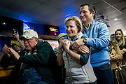 Senator and 2016 Republican presidential candidate, Ted Cruz (R-TX), hugs his wife, Heidi, as he prepares to speak to potential supporters during a campaign event at the Generations Bar and Grill in Ringsted, IA on January 29, 2016. Cruz is in Iowa campaigning in the final days before the Iowa Caucus. <br /> <br /> The Iowa Caucus is the first major electoral event of the nominating process for President of the United States. Both the Democratic and Republican Iowa Caucus will occur on February 1, 2016.