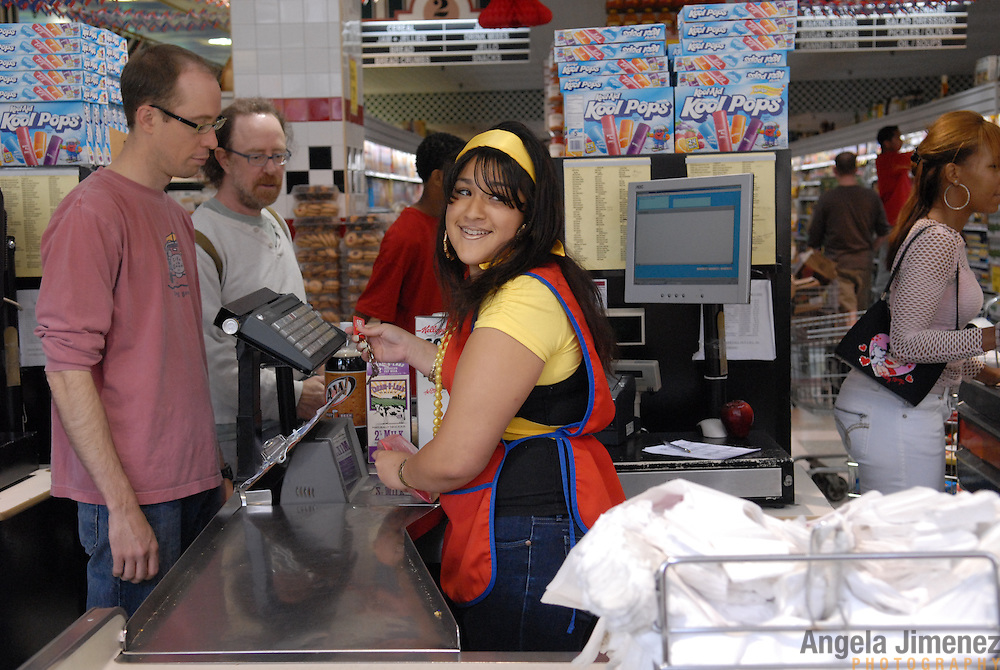 DATE: 6/7/07<br /> DESK: CTY<br /> SLUG: CTOWN<br /> ASSIGN ID: 30044113A<br /> <br /> Krystal Leon, 17,  looks over her shoulder at her one of her managers after asking for relief so she could go on her break during her cashier shift at Steve's C-Town, a grocery store on 9th Street between 5th and 6th Avenues in Park Slope, Brooklyn on June 7, 2007. <br /> <br />  <br /> photo by Angela Jimenez for The New York Times<br /> photographer contact 917-586-0916