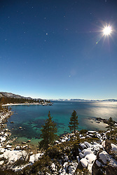 """""""Sand Harbor at Night 1"""" - Photograph of Sand Harbor in the distance shot at night (early morning) with the bright moon and stars visible."""
