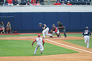 Ole Miss' Tanner Mathis (12) is out on a failed squeeze play as teammate Jake Overbey misses the bunt vs. Alabama at Oxford-University Stadium in Oxford, Miss. on Sunday, April 14, 2013. Ole Miss won 4-3 in 11 innings.