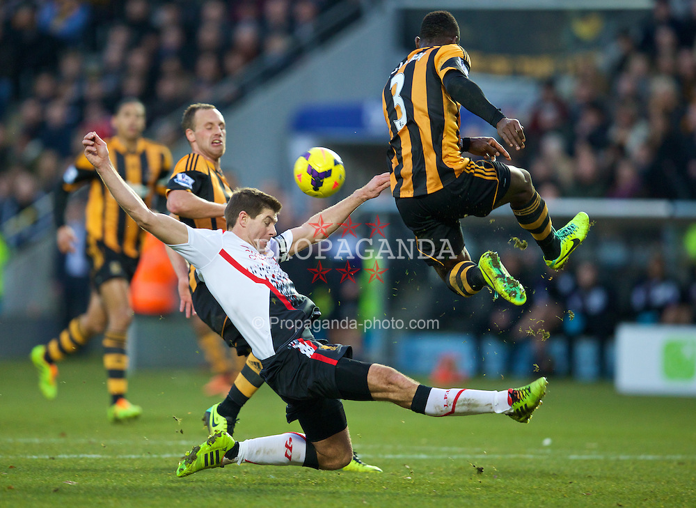 HULL, ENGLAND - Sunday, December 1, 2013: Liverpool's captain Steven Gerrard in action against Hull City's Maynor Figueroa during the Premiership match at the KC Stadium. (Pic by David Rawcliffe/Propaganda)