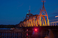 An eastbound DM&E train lights up the Canadian Pacific's massive swing bridge over the Mississippi River in Sabula, IA.
