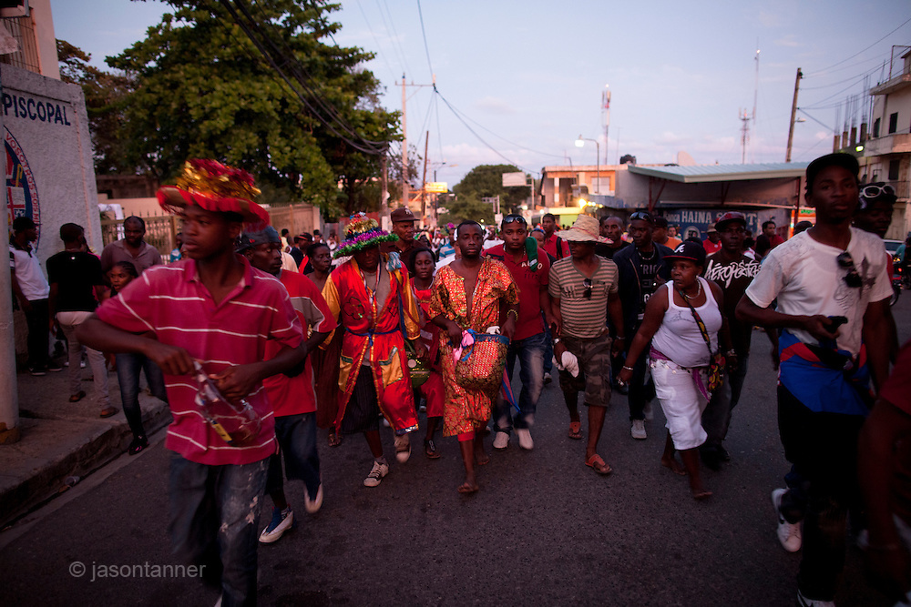 Dominican Republic: Bleo, a Vodú  priest and head of El GaGá de San Luis leads his procession (surrounded by bodyguards) in the town of Sabana Grande de Boya as part of the GaGá  procession of El GaGá de San Luis....At 38 years old he inherited the GaGá upon the death of his grandfather 10 years ago. He is promised to the GaGá for life and it must be continued by the eldest of his 3 children and grandchildren.