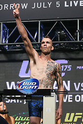 Las Vegas, Nevada, USA - July 4, 2014: George Roop steps on the scale for his preliminary card bout at UFC 175 at the Mandalay Bay Events Center in Las Vegas, Nevada.  Ed Mulholland for ESPN