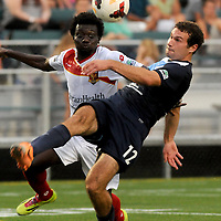 Wilmington's Steven Miller attempts a shot on goals against Arizona's Widner Saint-Cyr Friday July 25, 2014 at Legion Stadium in Wilmington, N.C. (Jason A. Frizzelle)