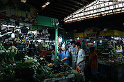 Patrons sort through produce at the Cubao Quezon City Farmer's market in Metro Manila, Philippines on March 1, 2016.