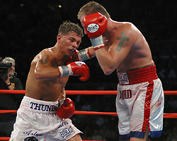 June 7, 2003; Atlantic City, NJ;  Arturo Gatti (white trunks) and Mickey Ward (white/red trunks) trade punches during their second fight at Boardwalk Hall in Atlantic City, NJ.