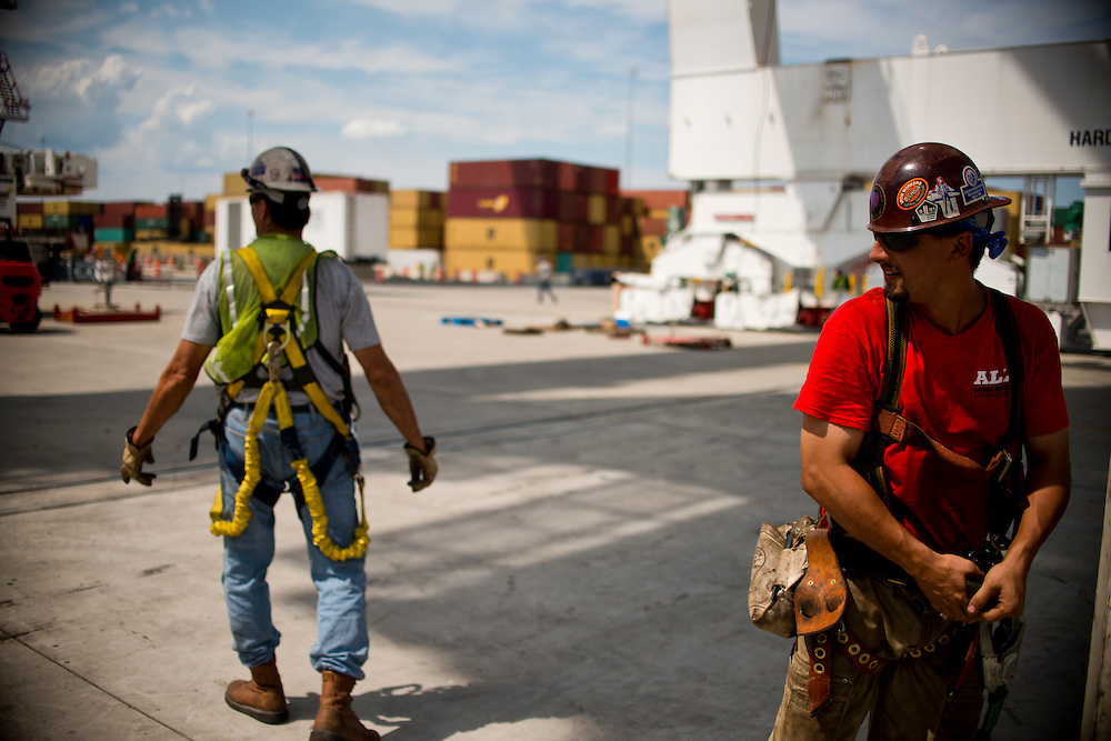 (photo by Matt Roth).Wednesday, July 11, 2012.Assignment ID: 30128574A..Ed Staylor, Jr., left, and Jimmy Orr, right, iron workers from local union 16, based out of Baltimore are part of the team erecting four super-post Panamax cranes to be erected at The Port of Baltimore's Seagirt Marine Terminal Wednesday, July 11, 2012. ..Once the building, testing and training is finished, the Seagirt terminal will join Norfolk, VA as one of the only two ports on the East Coast which can unload new Panamax sized container ships. The cranes are expected to be fully operational in September of this year.
