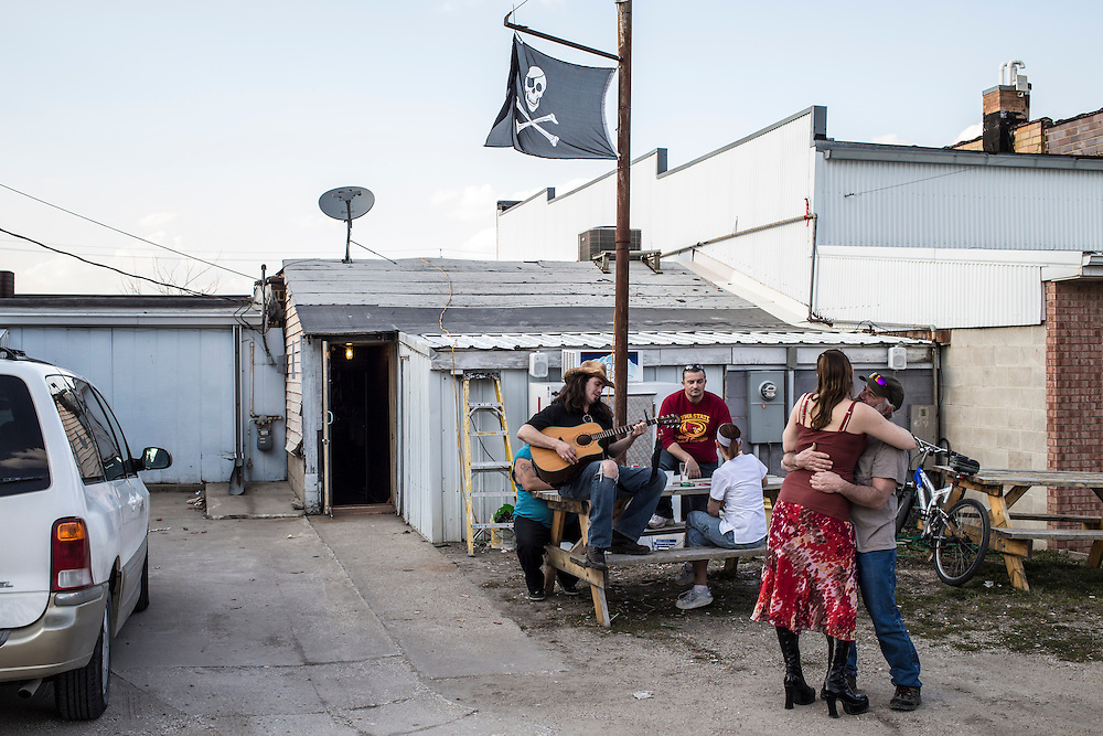 Patrons dance as Eric Freeman plays guitar behind Carpy's Ale House on Saturday, April 27, 2013 in Webster City, IA.