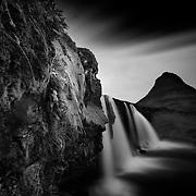 Kirkjufellsfoss waterfall and Kirkjufell mountain, Iceland, long exposure, B and W.