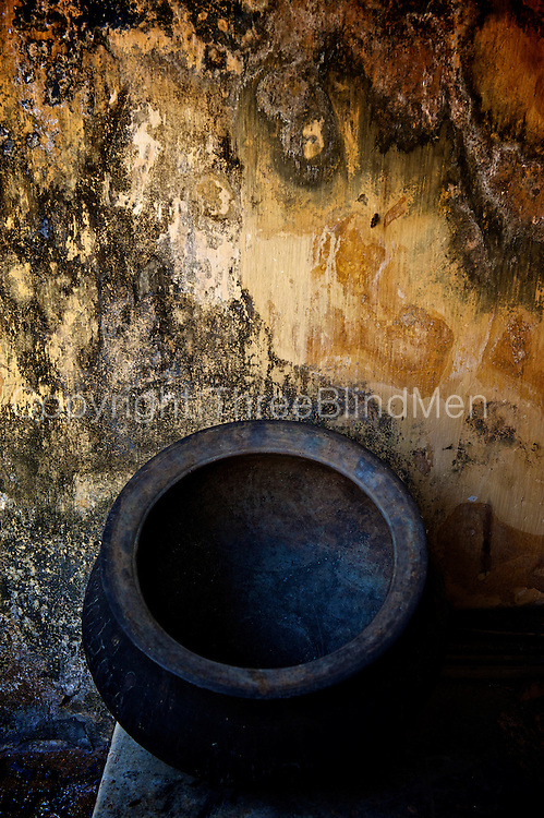 Cooking pot in a kitchen courtyard. A traditional square courtyard home called a Natcharam house. <br />