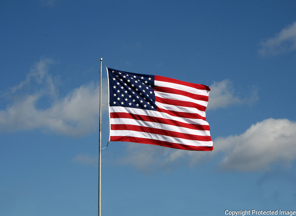 Large American Flag flying in a stiff wind.