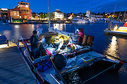 Racers do final preparation for the start of the race, at about 4am under the moonlight. <br /> <br /> Image from the 1st R2AK, Port Townsend's Race to Alaska. All the boats are wind and/or human powered (oars, paddles, pedals) ... no motors allowed. The race kicked off June 4, 2015, with the 1st leg to Victoria, B.C. http://r2ak.com/