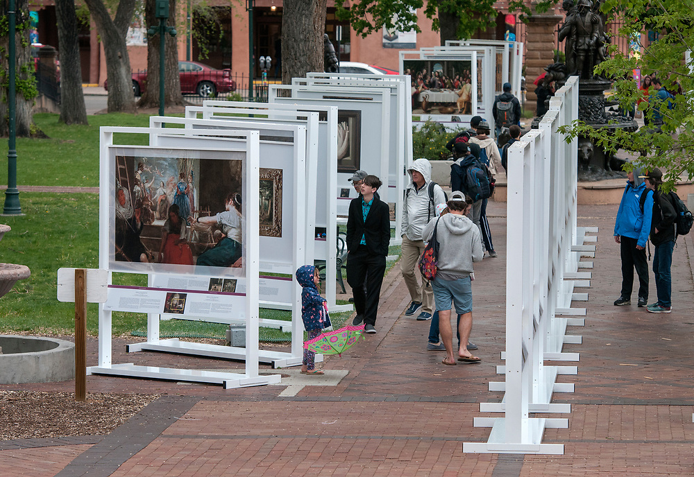 em051017d/jnorth/Dozens of people including an art school from Boulder Co., walk through The PRADO in Santa Fe exhibit in Cathedral Park Santa Fe, Wednesday May 10, 2017.  (Eddie Moore/Albuquerque Journal