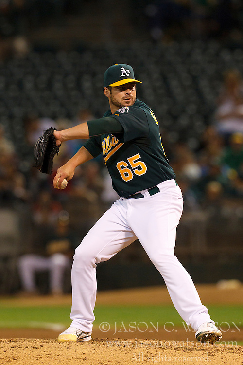 September 20, 2011; Oakland, CA, USA;  Oakland Athletics starting pitcher Graham Godfrey (65) pitches against the Texas Rangers during the seventh inning at O.co Coliseum.