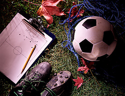 still life soccer ball shoes cleats green grass fall leaf coaches game strategy