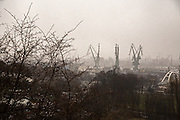 Iconic Gdansk shipyard cranes on horizon.<br /> <br /> Gdansk and Remontowa Shipyards