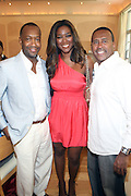 24 June 2010- Miami Beach, Florida- l to r:  Jeff Friday, Kenya Moore and Michael Baisden at the The 2010 American Black Film Festival Founder's Brunch held at Emeril's on June 24, 2010. Photo Credit: Terrence Jennings/Sipa