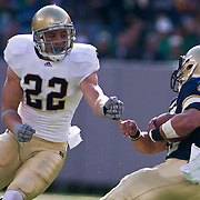 Navy FB (#39) Alexander Teich demonstrates why Navy is 5-2 as Teich powers his way up field for positive yards while Freshmen Safety (#22) Harrison Smith attempts to stop Teich. Navy defeats Notre Dame 35-17 at The New Giant's Stadium in East Rutherford New Jersey