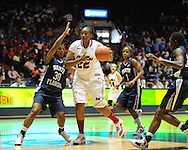 "Ole Miss' Nikki Byrd (22) drives for two points vs. North Florida's Jasmine Hicks (30), Fabiola Josil (1), and Octavia Langston (32) at the C.M. ""Tad"" Smith Coliseum in Oxford, Miss. on Friday, November 11, 2011."