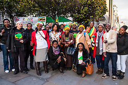 A delegation of Zimbabweans from the weekly Zimbabwe Vigil protest that has been held at Zimbabwe House in London for over 10 years, delivered a petition to Downing Street objecting to the lifting of EU sanctions against the aging Mugabe's regime despite the fact that there have been no political reforms in the country whose large population in the diaspora are denied their right to vote, and where rigging and intimidation are the order of the day in Presidential and Parliamentary elections. PICTURED: Zimbabwe Vigil protesters pose for a group picture outside the Zimbabwean embassy prior to marching to Downing Street.