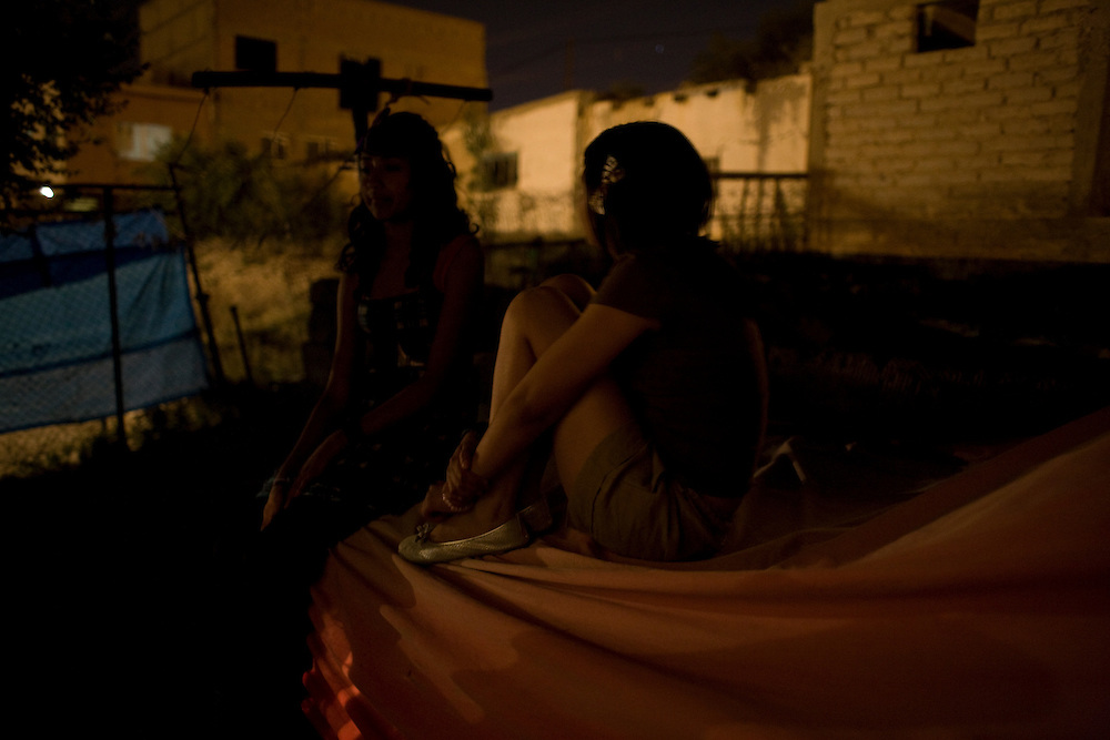 Two young girls hang out in the Diaz Ordaz colonia in Ciudad Juarez, Chihuahua on May 13, 2010.
