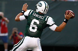 Aug 14, 2009; East Rutherford, NJ, USA;   New York Jets quarterback Mark Sanchez (6) throws his first pass during the first half at Giants Stadium.