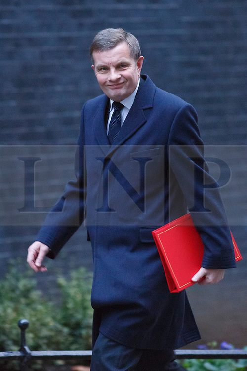 © licensed to London News Pictures. London, UK 07/01/2014. Welsh Secretary, David Jones attending to a cabinet meeting in Downing Street on Tuesday, 7 January 2014. Photo credit: Tolga Akmen/LNP