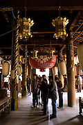 """People praying in the main building of Ishiyamadera temple where lady Murasaki started writing """"The Tale of Genji"""" , a 1000 years ago.."""
