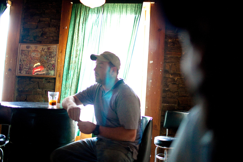 A man has a drink at a bar in Lockport, NY, on Thursday, July 30, 2009.