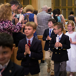 Patrick O'Leary, 9, was photographed by his parents John and Beth as he recessed after Mass at Holy Redeemer Church, where Patrick received First Communion. <br /> <br /> Teak Phillips | St. Louis Review | @TeakPhillips